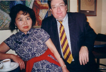 John with famous painter and artist Miss Bing Wu, May 2002