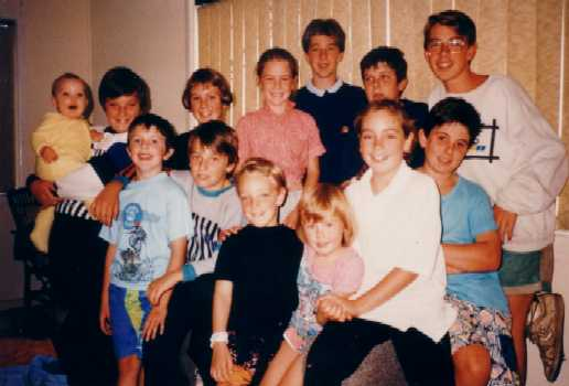 John's 13 Nieces and Nephews - The Eldest (blue jumper, centre rear) is now 30 years old