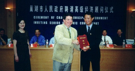 Award Ceremony with Mayor of Chahou city, China. Appointed Economic Consultant to the Province